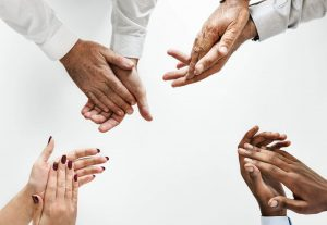 Four people showing hands